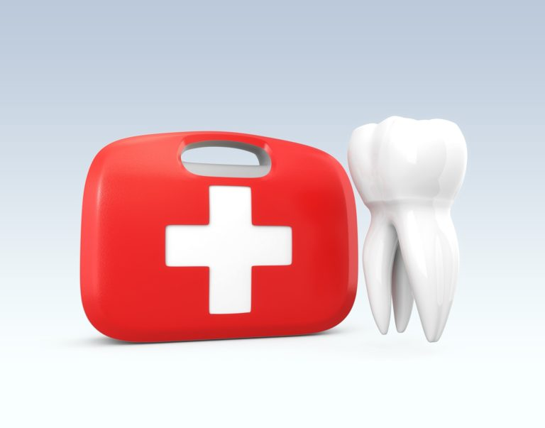 Red first aid bag with tooth representing emergency dental services from capital dental in lincoln nebraska